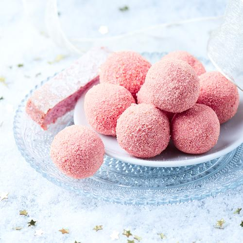 Pink truffles with white chocolate and pink biscuits from Reims